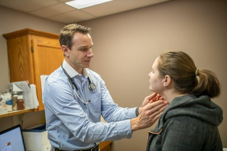 A physician examines a patient